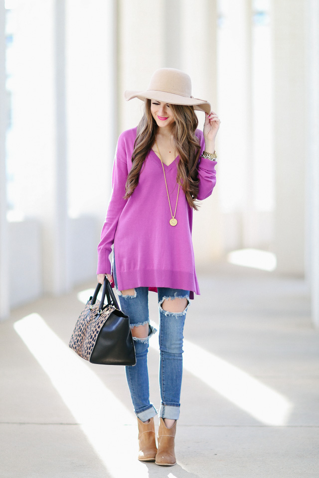 ripped jeans outfit inspiration booties purple sweater