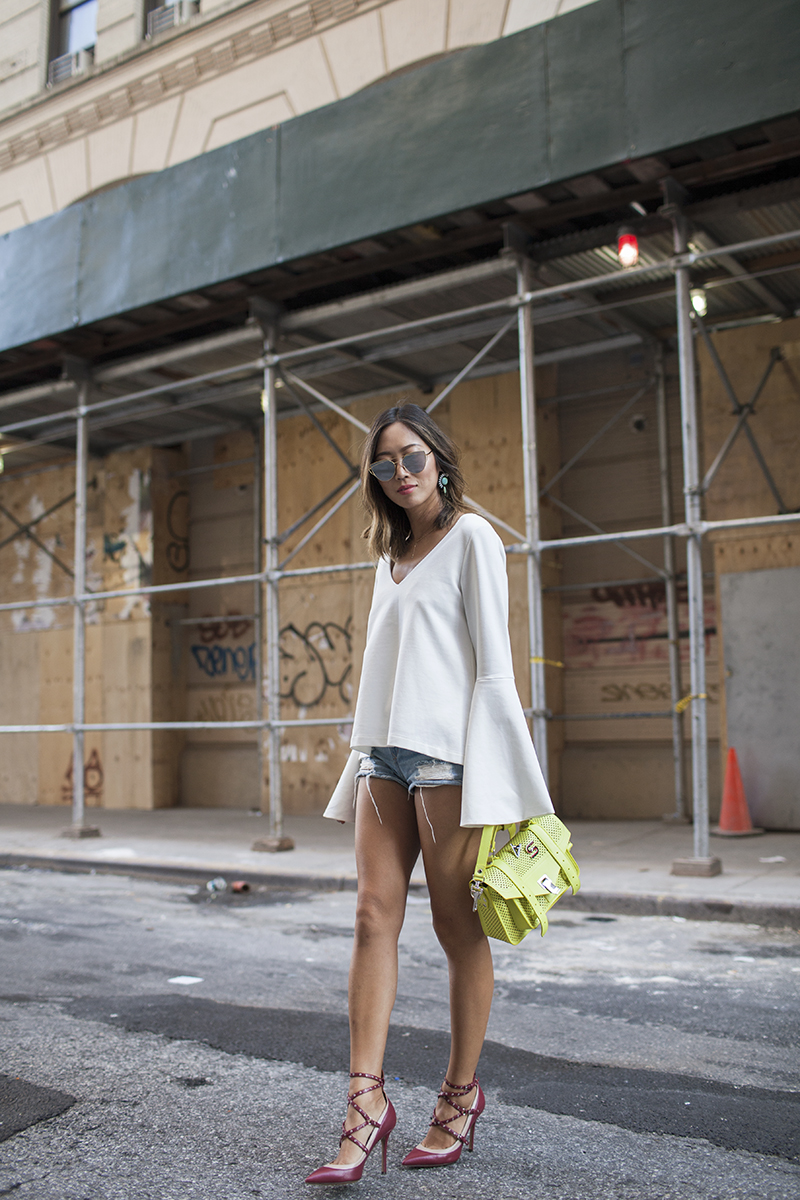 aimee_song_of_style_lionette_earrings_two_songs_bell_sleeves_blouse_denim_shorts_valentino_studded_heels_proenza_schouler_initial_bag